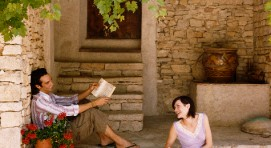 Young Couple Sit on Stone Steps Outside a Cottage Reading Books